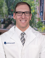 Daniel R Frisch MD